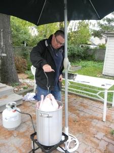 Deep frying the turkey.