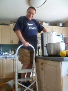 My husband stirring the tomato sauce that we eventually canned.