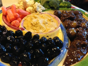The green olives were the best I've ever eaten. They were purchased at the Iranian market. The marinade included ground walnuts and it became a great dipping sauce as well.
