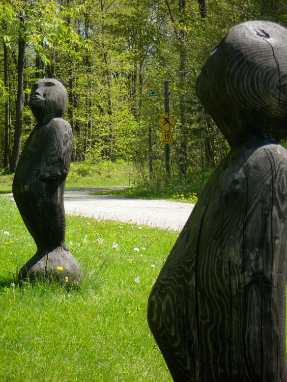 Sculptures surrounding the totem pole.